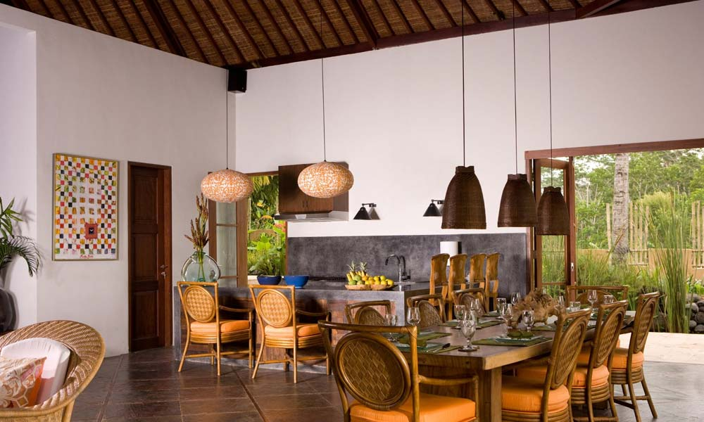 Dining area with restaurant-style open kitchen at Villa Bayad