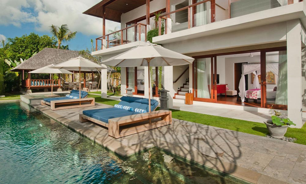 Daybeds by the pool at Villa Joss
